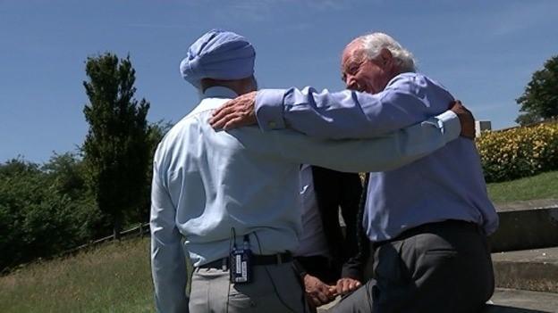 Grandsons Jamail & Ian embrace at Manta Singhs Memorial